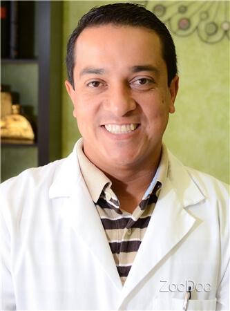 Dr. Carlos Breton, DDS