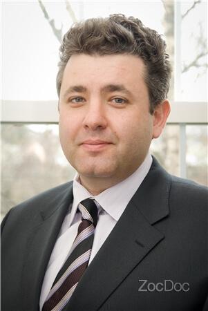 Dr. Dmitry Kucher, DDS