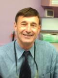 Dr. Warren Ravner, DMD